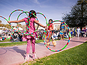 06 FEBRUARY 2011 - PHOENIX, AZ: QOOTSVENA DENIPAH-COOK, 10 years old, (center) a Navajo Hopi Indian from the Okhay-Owingeh pueblo in New Mexico, warms up before dancing at the 21st Annual Heard Museum World Championship Hoop Dance Contest at the Heard Museum in Phoenix, AZ, Sunday, February 6. Hoop dancing has a long tradition among Native American peoples. The hoop or circle is symbolic to most Native people. It represents the Circle of Life and the continuous cycle of summer and winter, day and night, male and female. Some native people use hoop dancing as a part of healing ceremonies designed to restore balance and harmony in the world.      Photo by Jack Kurtz