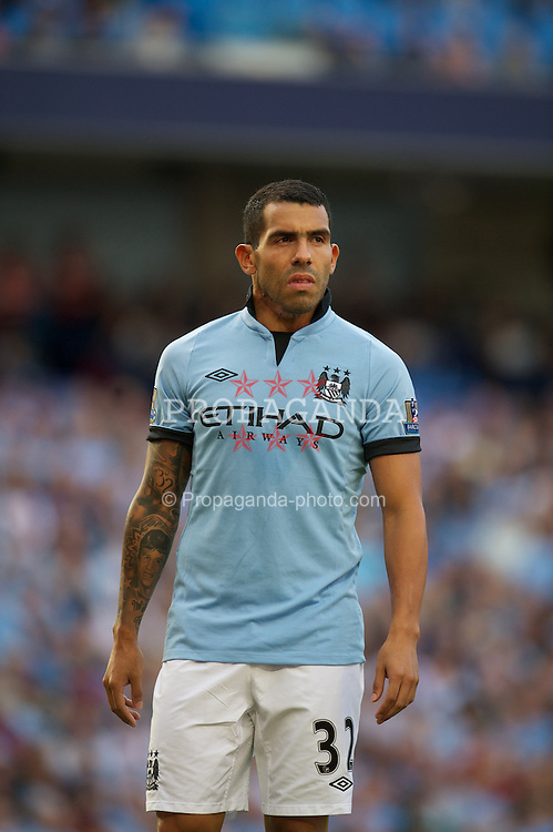 MANCHESTER, ENGLAND - Saturday, September 1, 2012: Manchester City's Carlos Tevez in action against Queens Park Rangers during the Premiership match at the City of Manchester Stadium. (Pic by David Rawcliffe/Propaganda)
