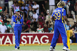 © Licensed to London News Pictures. 14/02/2012. Adelaide Oval, Australia. Sri Lankan captain Mahela Jayawardena (right) shows some frustration toward bowler Lasith Malinga (center) after missing a run out chance at a crucial stage of the game during the One Day International cricket match between India Vs Sri Lanka. Photo credit : Asanka Brendon Ratnayake/LNP