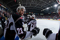 KELOWNA, CANADA - MARCH 16: Jadon Joseph #23 of the Vancouver Giants stands on the bench and celebrates a first period goal against the Kelowna Rockets  on March 16, 2019 at Prospera Place in Kelowna, British Columbia, Canada.  (Photo by Marissa Baecker/Shoot the Breeze)