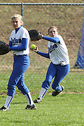Caitlyn Ford (right) throws in a ball from center field during Madison's varsity softball game with Fluvanna on Saturday, March 27.  Ford was 2 for 4 at the plate with 2 RBIs in the Mountaineers 7-1 win over the Flucos.  Date: 03 27, 2010,   MCHS Varsity Softball vs Fluvanna Flucos.  Madison defeats Fluvanna 7-1.  Jordan Aylor gets the complete game win on the mound.