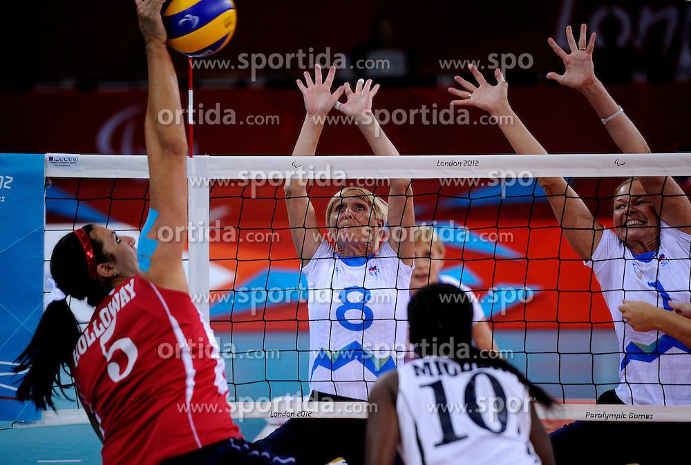 01-09-2012 ZITVOLLEYBAL: PARALYMPISCHE SPELEN 2012 USA - SLOVENIE: LONDEN.In ExCel South Arena wint USA van Slovenie / Danica GOSNAK, Anita GOLTNIK URNAUT.©2012-FotoHoogendoorn.nl.