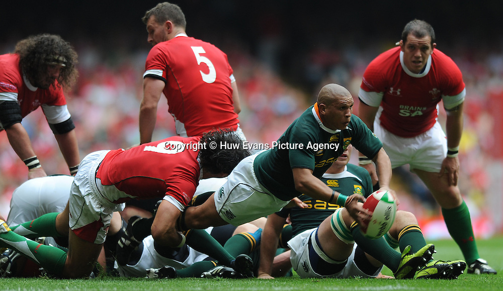 05.06.10 - Wales v South Africa - Principality Building Society Summer Test -<br /> Ricky Januarie of South Africa gets the ball away as Mike Phillips of Wales tackles.<br /> &copy;Huw Evans Picture Agency