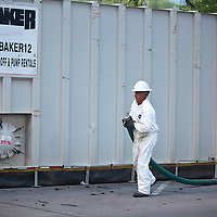 Oil cleanup worker in Liberty Park, Salt Lake City