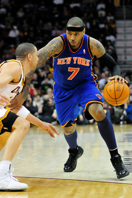 Feb. 25, 2011; Cleveland, OH, USA; New York Knicks small forward Carmelo Anthony (7) tries to drive around Cleveland Cavaliers shooting guard Anthony Parker (18) during the fourth quarter at Quicken Loans Arena. The Cavaliers beat the Knicks 115-109. Mandatory Credit: Jason Miller-US PRESSWIRE