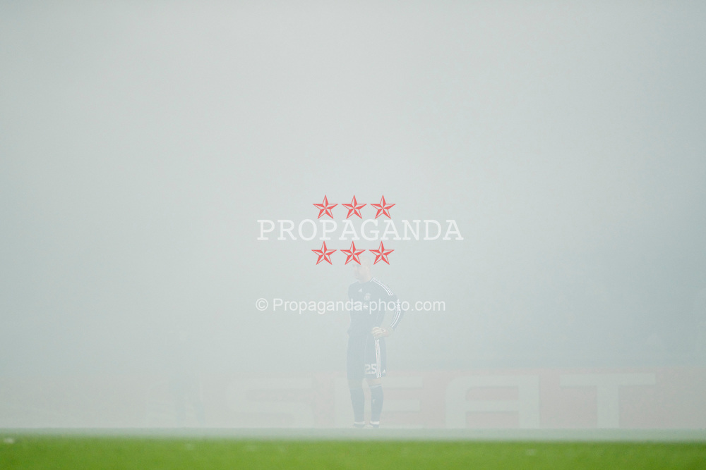 PRAGUE, CZECH REPUBLIC, Thursday, February 17, 2011: Liverpool's goalkeeper Jose Reina is engulfed by smoke after AC Sparta Prague supporters set off a flare during the UEFA Europa League Round of 32 1st leg match at the Letna? Stadion . (Photo by David Rawcliffe/Propaganda)