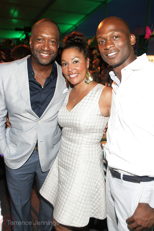 Water Mill, New York: (L-R) Jeff Friday, CEO & Founder, The Film Life, Lucinda Martinez, VP, Domestic Network Distribution and Multicultural Marketing and Dennis Williams, VP, Corporate Affairs, HBO attend the RUSH Philanthropic Arts Foundation 15th Annual Art For Life Benefit Gala held in the Hamptons at the Farmview Farms on July 26, 2014  in Water Mill, New York. (Terrence Jennings)