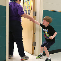 Carter Warren, 5, an incoming Kindergartner at Saltillo Primary School, tries to pulls away from his mother Donna, as they walk into Mrs. Marlane Dunn's class on the first day of school in Saltillo Thursday morning.