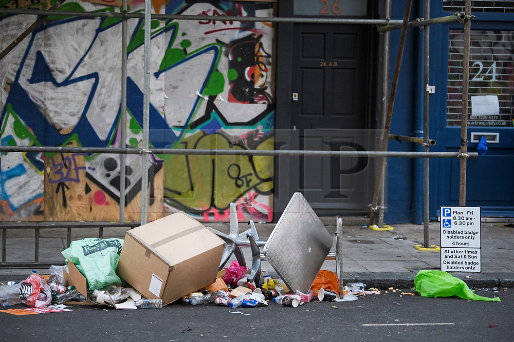 © Licensed to London News Pictures. 27/08/2019. London, UK. Rubbish and debris remains on the streets around Notting Hill, west London, in the aftermath of the 2019 Notting Hill carnival. The two day event is the second largest street festival in the world after the Rio Carnival in Brazil, attracting over 1 million people to the streets of West London. Photo credit: Ben Cawthra/LNP