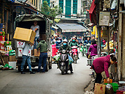 "22 DECEMBER 2017 - HANOI, VIETNAM:  A street scene in the old quarter of Hanoi. The old quarter is the heart of Hanoi, with narrow streets and lots of small shops but it's being ""gentrified"" because of tourism and some of the shops are being turned into hotels and cafes for tourists and wealthy Vietnamese.   PHOTO BY JACK KURTZ"