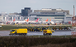 © Licensed to London News Pictures. 29/02/2016. Gatwick, UK. Vehicles with cleaning equipment, clean the runway at Gatwick Airport in West Sussex, where the main runway has been closed due to a spillage. Photo credit: Peter Macdiarmid/LNP