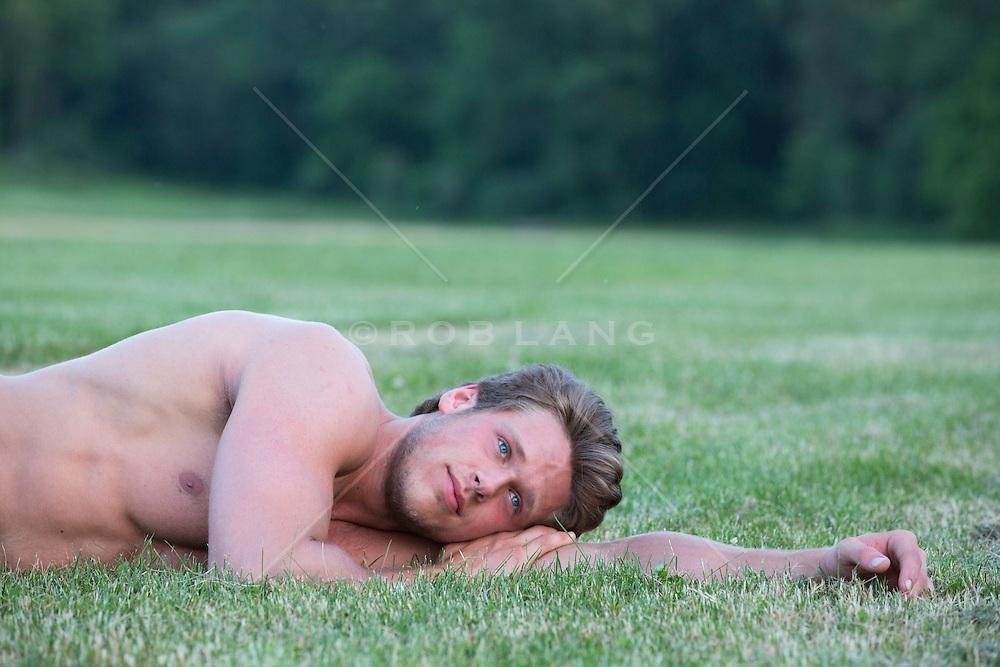 shirtless guy relaxing in grass
