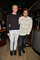 Left to right, TOMAS AUKSAS and PABLO GANGULI at the opening party for the KPH Pub at 139 Ladbroke Grove,London on 29th January 2014.