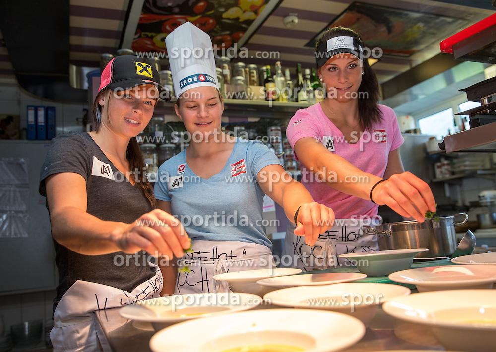 03.07.2014, Hotel der Seehof, Goldegg, AUT, OeSV Trainingscamp, Speedteam Damen, im Bild v.l. Anna Fenninger (AUT), Ramona Siebenhofer (AUT), Miriam Puchner (AUT) // Austrian's Anna Fenninger, Ramona Siebenhofer and Miriam Puchner working in the kitchen during a training Camp of Austrian Ski Team at the Hotel der Seehof, Goldegg, Austria on 2014/07/03. EXPA Pictures © 2014, PhotoCredit: EXPA/ Johann Groder