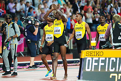 London, August 12 2017 . Usai Bolt applauds the crowd as he crosses the finish line  assisted by his teammates after suffering an injury to his hamstring as he ran the final 100m in the men's 4x 100m relay  on day nine of the IAAF London 2017 world Championships at the London Stadium. © Paul Davey.