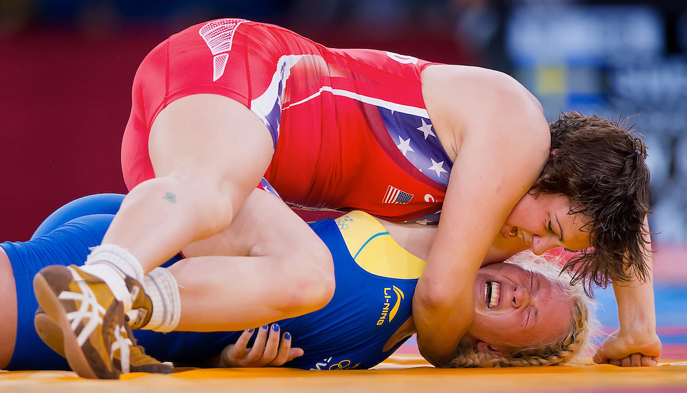 Ali Sue Bernard of the United States, top, wrestled with Jenny Fransson of Sweden, bottom, in women's 72kg freestyle wrestling competition at the ExCeL centre during the 2012 Summer Olympic Games in London, England, Thursday, August 9, 2012. Fransson won the match 3-1. (David Eulitt/Kansas City Star/MCT)