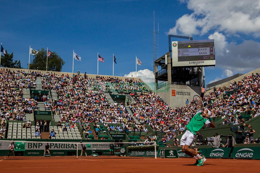 June 5, 2017 - Paris, France - Fernando Verdasco of Spain serves against Kei Nishikori of Japan during the fourth round at Roland Garros Grand Slam Tournament - Day 9 on June 5, 2017 in Paris, France. (Credit Image: © Robert Szaniszlo/NurPhoto via ZUMA Press)