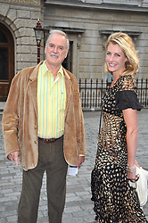 JOHN CLEESE and LISA HOGAN at the Royal Academy of Arts Summer Party held at Burlington House, Piccadilly, London on 3rd June 2009.