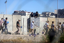 June 16, 2017 - Ramallah, West Bank, Palestinian Territory - Palestinians make their way through the Israeli Qalandia checkpoint, in the occupied West Bank between Ramallah and Jerusalem, to attend Friday prayer of the holy fasting month of Ramadan in Jerusalem's al-Aqsa mosque.  (Credit Image: © Stringer/APA Images via ZUMA Wire)