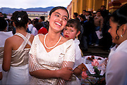 FEB 24, 2001 - SAN CRISTOBAL DE LAS CASAS, CHIAPAS, MEXICO: A teenage girl, an attendant at a Quincenera, or Mexican girl's 15th birthday, waits to enter the cathedral in San Cristobal de las Casas, Chiapas, Mexico. © Jack Kurtz  CULTURE  RELIGION  WOMEN  FAMILY