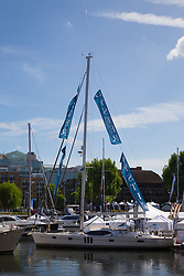 St Katherine Dock in London hosts the London On-Water Boat Show with boatbuilders, cruising companies and accessories businesses displaying their products on floating pontoons among the boats. London, May 11 2018.