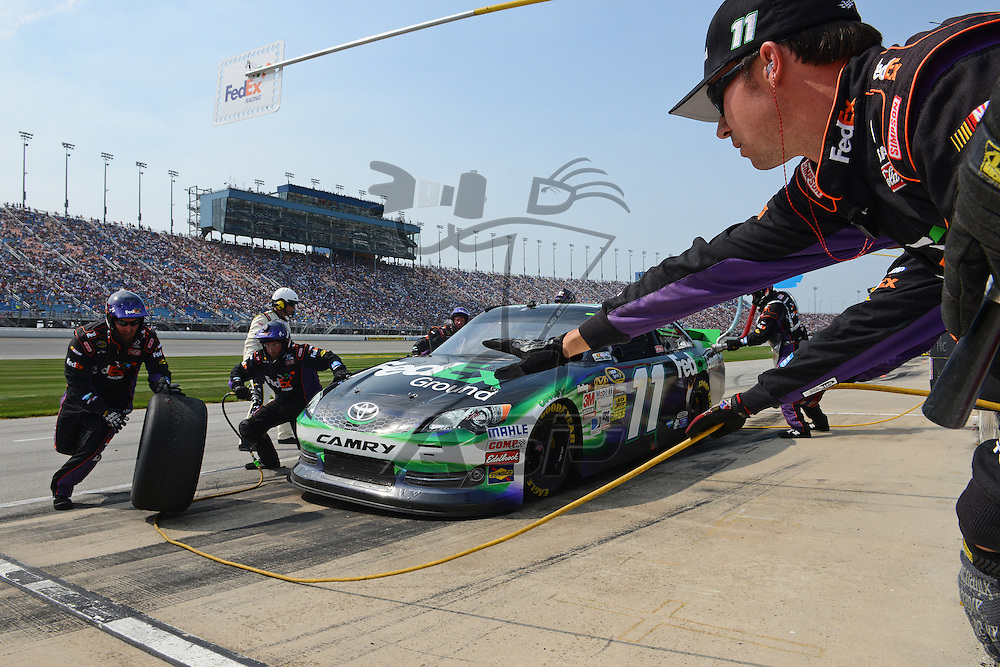 Joliet, IL - SEP 16, 2012: Denny Hamlin (11) makes a pit stop for the Geico 400 at the Chicagoland Speedway in Joliet, IL.