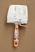 still life of a big paint brush with white paint
