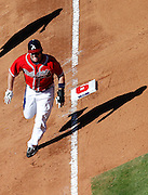 ATLANTA - OCTOBER 3:  Outfielder Matt Diaz #23 of the Atlanta Braves rounds third base on his way to score in the fourth inning during the game against the Philadelphia Phillies at Turner Field on October 3, 2010 in Atlanta, Georgia.  The Braves beat the Phillies 8-7.  (Photo by Mike Zarrilli/Getty Images)
