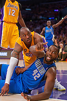 02 April 2013: Guard (24) Kobe Bryant of the Los Angeles Lakers and (42) Elton Brand of the Dallas Mavericks call for possession tot he official during the first half of the Lakers 101-81 victory over the Mavericks at the STAPLES Center in Los Angeles, CA.