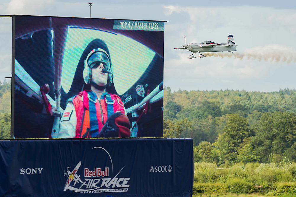 Matthias Dolderer (Ger) finishes fourth in the final - Red Bull Air Race World Championships at Ascot Race Course. A combination of high speed, low altitude and extreme manoeuvrability make it only accessible to the 'world's most exceptional pilots'. 12 pilots compete in the Master Class category in eight races across the globe for the title of 2014 Red Bull Air Race World Champion. The objective is to navigate an aerial racetrack featuring air-filled pylons in the fastest possible time, incurring as few penalties as possible. All 12 pilots race with a standardised propulsion package – a high-performance, race-tuned standardised engine (Lycoming Thunderbolt) and standardised propellers (Hartzell 3-bladed). They do have a chooice of 3 single engine/seater aircraft - the Zivko Aeronautic Edge 540, the MXS-R and the Hungarian University of Aviation's Corvus Racer 540 - all cappable of around 230kts and of surviving high G forces, 10+. A new feature of the 2014 Red Bull Air Race World Championship is the debut of the new Challenger Cup, giving a new generation of talented pilots from around the world a chance to race. Entertainement is provided by the Red Arrows and the Breitling Wingwalkers, amongst others.  Ascot Racecourse, High St, Ascot, Berkshire, UK.