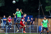 AFC Wimbledon defender Terell Thomas (6) heads clear during the Pre-Season Friendly match between Hampton & Richmond and AFC Wimbledon at Beveree Stadium, Richmond Upon Thames, United Kingdom on 27 July 2019.