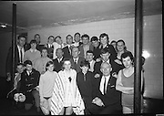 The Royal Life Saving Society Gala.<br /> 1965.<br /> 12.11.1965.<br /> 11.12.1965.<br /> 12th November 1965.<br /> Today saw the 22nd holding of the R.L.S.S,gala at the Iveagh Baths. The gala was a competition of all aspects of water safety and life saving tecniques. Competitors ranged in age from U14s to adult.<br /> Picture shows a group of officials and competitors from the Royal Life Saving Club, Cork. Some of those included in the photograph are Mr Tadgh Philpott, Hon Representative,Mr Con O'Leary,Assistant Hon Representative,Mr Evan Byrne ,Team Trainer, Mrs Tadgh Philpott, Mr Jimmy Murphy, Mr Paddy Geoghegan and Ms Lucy Leonard.