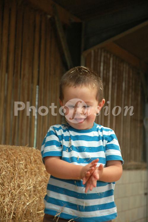 Children in play barn at childrens farm UK