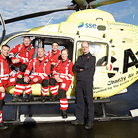 FREE TO USE PHOTOGRAPH....30.10.15<br /> Scotland's Charity Air Ambulance (SCAA) unveiled it's new helicopter at Perth airport this morning a EC135 T2i (pictured) which replaces the Bolkow 105 helicopter which is retiring from service. The new helicopter will increase speed, range, endurance and payload, allow SCAA to fly at night and in cloud. The SCAA team from left, Mark Tynan, Craig McDonald, John Salmond, Lead Paramedic John Pritchard, Julia Barnes and Chief Pilot Captain Russell Myles<br /> for further info please contact Maureen Young on 07778 779000<br /> Picture by Graeme Hart.<br /> Copyright Perthshire Picture Agency<br /> Tel: 01738 623350  Mobile: 07990 594431