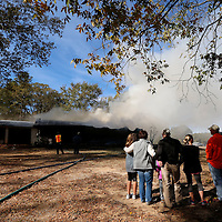Thomas Wells | BUY at PHOTOS.DJOURNAL.COM<br /> Freinds and family can only watch as fire fighters from Shannon, Verona, Union and Nettleton battle a blaze on Lee County Road 857 Tuesday morning. The home was a total loss.