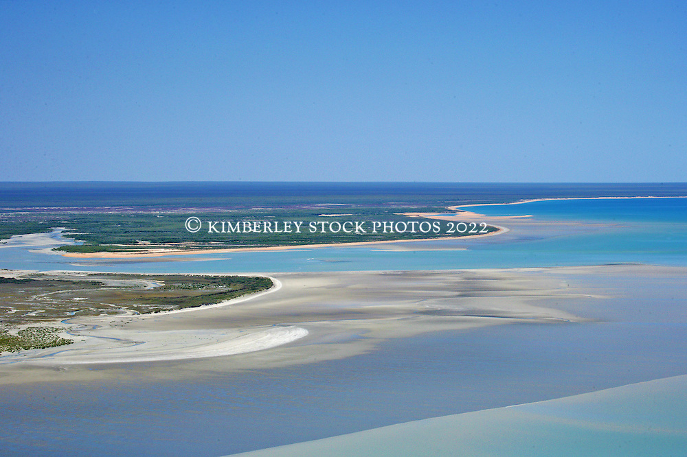 Aerial view showing the vast expanses of mud and sand banks that are exposed by the tide in Roebuck Bay on the Kimberley coast.