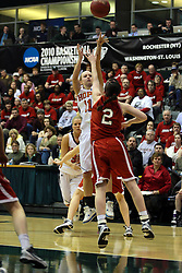 20 March 2010: Miranda DeKuiper pushes forward and takes a shot against Alex Hoover.The Flying Dutch of Hope College fall to the Bears of Washington University 65-59 in the Championship Game of the Division 3 Women's NCAA Basketball Championship the at the Shirk Center at Illinois Wesleyan in Bloomington Illinois.