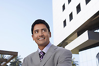 Business man using mobile phone outdoors