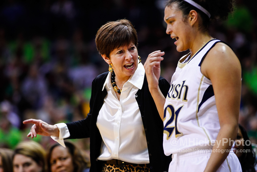 SOUTH BEND, IN - MARCH 04: Head coach Muffet McGraw of the Notre Dame Fighting Irish talks to Kayla McBride #21 of the Notre Dame Fighting Irish during the game against the Connecticut Huskies at Purcel Pavilion on March 4, 2013 in South Bend, Indiana. Notre Dame defeated Connecticut 96-87 in triple overtime to win the Big East regular season title. (Photo by Michael Hickey/Getty Images) *** Local Caption *** Muffet McGraw; Kayla McBride