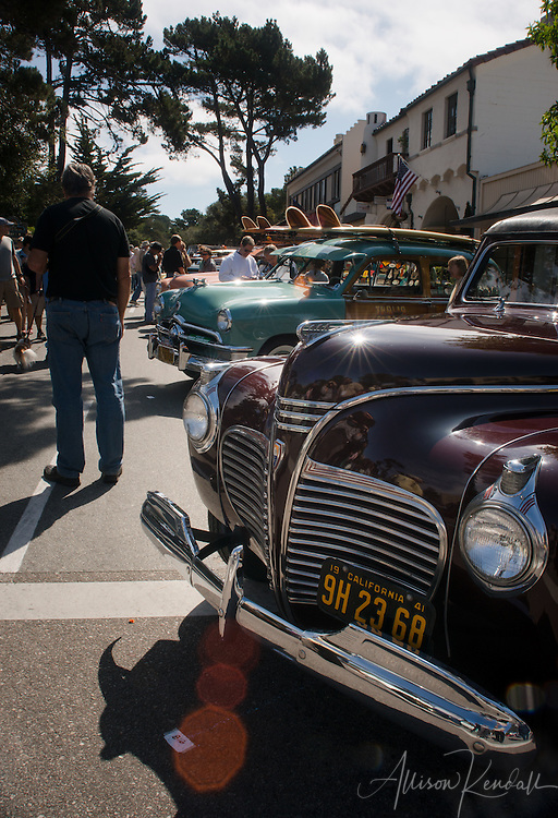 Ford Woody collection, lining the sunny Carmel-by-the-Sea Avenue during Monterey Car Week
