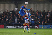 AFC Wimbledon defender Terell Thomas (6) winning header during the The FA Cup match between AFC Wimbledon and Doncaster Rovers at the Cherry Red Records Stadium, Kingston, England on 9 November 2019.