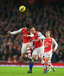LONDON, ENGLAND - Saturday, November 22, 2014: Arsenal's captain Mikel Arteta and Kieran Gibbs clash against Manchester United during the Premier League match at the Emirates Stadium. (Pic by David Rawcliffe/Propaganda)