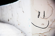 Smiley face, leading lines, cracked paint texture - all work for an image in this series.