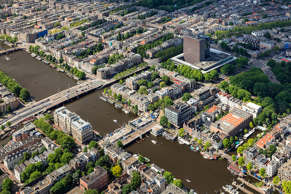 Nederland, Noord-Holland, Amsterdam, 14-06-2012; Amstel met bij het Amstelhotel de Hogesluis (wordt gerenoveerd), het gebouw van de Nederlandse Bank (m, r) en de Torontobrug..The river Amstel with its sluices and bridges, Amsterdam center. Amstel Hotel (b,r) and the building of the Dutch national Bank (m,r)..luchtfoto (toeslag), aerial photo (additional fee required).foto/photo Siebe Swart