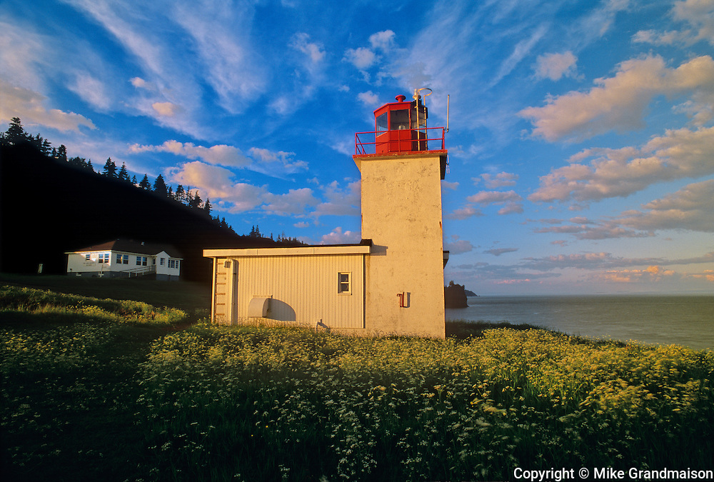 Cape d'Or Lighthouse on the Bay of Fundy at sunset<br /> Advocate Harbour<br /> Nova Scotia<br /> Canada
