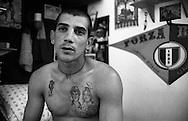Roma Giugno 2000.Carcere di Rebibbia N.C..Un giovane detenuto con un tatuaggio raffigurante i genitori morti...Rome June 2000.Prison Rebibbia N.C..A young inmate with a tattoo depicting his parents dead.