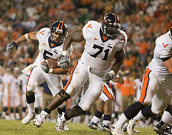 Virginia running back Mikell Simpson (5) rushes behind the blocking of Virginia guard Branden Albert (71).  The #19 Virginia Cavaliers defeated the Miami Hurricanes 48-0 at the Orange Bowl in Miami, Florida on November 10, 2007.  The game was the final game played in the Orange Bowl.