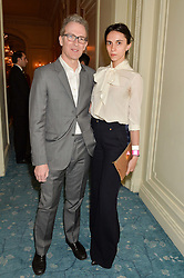 ASHLEY HICKS and his wife KATA DE SOLLIS at a party to celebrate the publication of The Romanovs 1613-1918 by Simon Sebag-Montefiore held at The Mandarin Oriental, 66 Knightsbridge, London on 2nd February 2016.