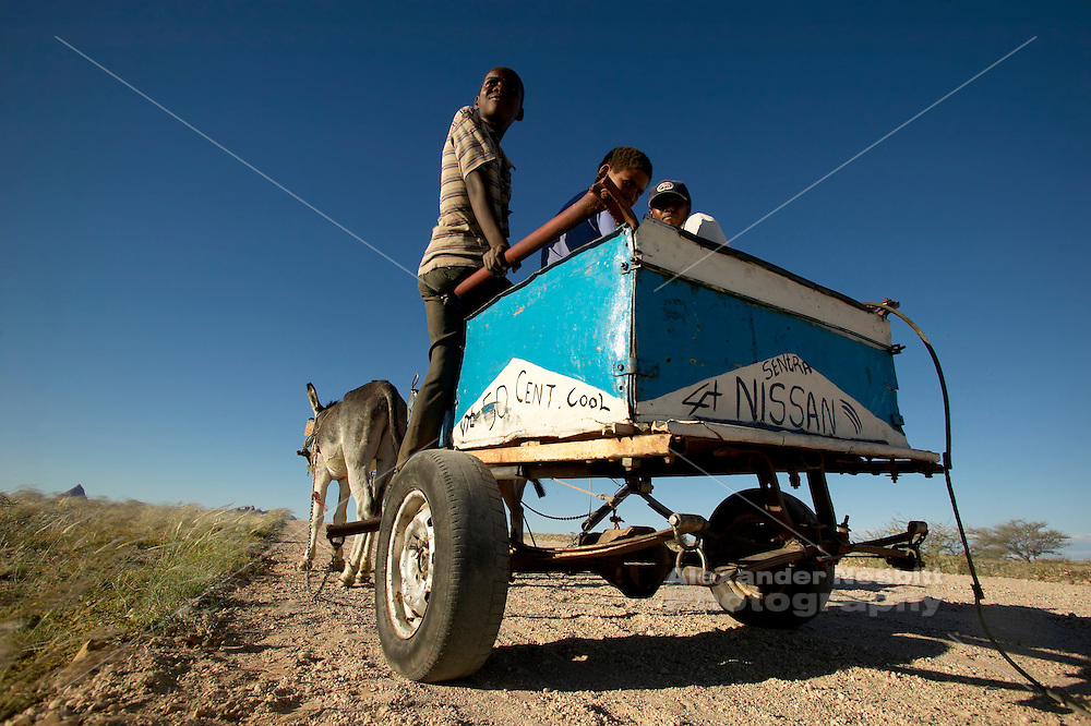 """Namibia, 2004 - Boys with a donkey cart on which they have painted """"4x4"""" and """"Nissan Sentra"""""""
