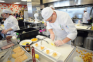 Student chef David Maga, right, works on his dish as he competes in the final round of the Culinary Arts Institute of Montgomery County Community College Student Iron Chef Competition during Open House Saturday April 16, 2016 at Culinary Arts Institute in Towamencin, Pennsylvania. (Photo by William Thomas Cain)